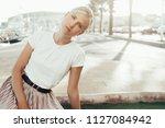 young attractive blonde girl is ...   Shutterstock . vector #1127084942