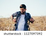 male hiker putting on a...   Shutterstock . vector #1127097392