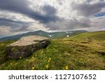 wide panorama of lit by sun... | Shutterstock . vector #1127107652