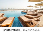 hotel swimming pool  outdoor ... | Shutterstock . vector #1127144618