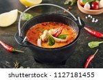 Stock photo tom yum or tom yam with squid shrimp chili peppers lime juice galangal fish sauce lemongrass 1127181455