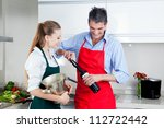 man and woman opening wine... | Shutterstock . vector #112722442