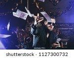 a wealthy mature man smoking...   Shutterstock . vector #1127300732