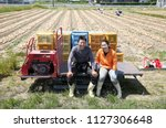 farmer's japanese young couple | Shutterstock . vector #1127306648