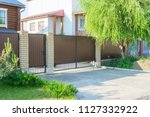 brown automatic gates in the... | Shutterstock . vector #1127332922