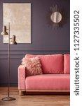 furry pillow on a powder pink...   Shutterstock . vector #1127335502
