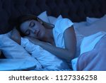 Young Woman Sleeping In Bed At...