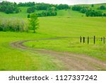 rural country road leading to... | Shutterstock . vector #1127337242