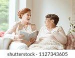 happy nurse reading a funny... | Shutterstock . vector #1127343605