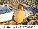 portrait of young woman reading ... | Shutterstock . vector #1127362082