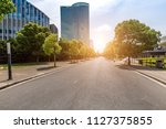 empty road with modern business ... | Shutterstock . vector #1127375855