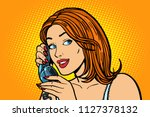 smiling woman talking on the...   Shutterstock .eps vector #1127378132