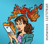 woman with a burning phone. hot ... | Shutterstock .eps vector #1127378165