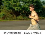 a young caucasian adult male... | Shutterstock . vector #1127379836