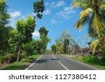 road through balinese village... | Shutterstock . vector #1127380412