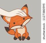 hand patting fox head | Shutterstock .eps vector #1127380595