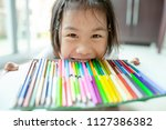 kidding asian children and tray ... | Shutterstock . vector #1127386382