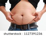 fat man used hand for check his ...   Shutterstock . vector #1127391236