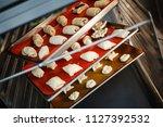 dessert baking on baking trays... | Shutterstock . vector #1127392532