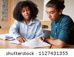 high school tutor giving male... | Shutterstock . vector #1127431355