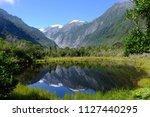 new zealand landscape water... | Shutterstock . vector #1127440295