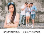 upset young chinese girl is... | Shutterstock . vector #1127448905