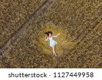 Young Girl In A Wheat Field....