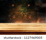 old wood table with blured... | Shutterstock . vector #1127469005