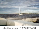 lighthouse  waves and yacht  in ... | Shutterstock . vector #1127478638