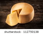 Cheese Wheel On Wood. Organic...