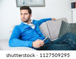 young male client waiting... | Shutterstock . vector #1127509295