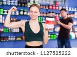 athletic girl with jar of... | Shutterstock . vector #1127525222