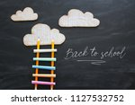 ladder made of colorful chalks... | Shutterstock . vector #1127532752