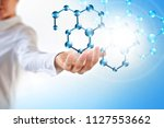 molecules in the hand ... | Shutterstock . vector #1127553662