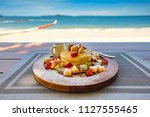 delicious pancakes served with... | Shutterstock . vector #1127555465