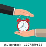 hand with red alarm clock.... | Shutterstock .eps vector #1127559638