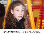 a young curly girl at the fun... | Shutterstock . vector #1127600402