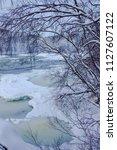 almost frozen stream in the... | Shutterstock . vector #1127607122