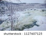 almost frozen stream in the... | Shutterstock . vector #1127607125