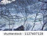 almost frozen stream in the... | Shutterstock . vector #1127607128
