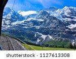 swiss alps rail tour   Shutterstock . vector #1127613308