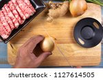 chef cutting onion before... | Shutterstock . vector #1127614505
