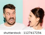 the attractive angry couple... | Shutterstock . vector #1127617256
