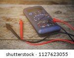 digital multimeter and wiring... | Shutterstock . vector #1127623055