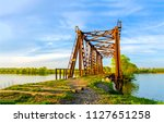 rusty abandoned railway bridge... | Shutterstock . vector #1127651258