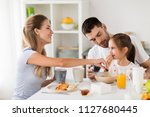 family  eating and people... | Shutterstock . vector #1127680445