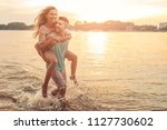 shot of an affectionate young... | Shutterstock . vector #1127730602