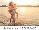 shot of an affectionate young... | Shutterstock . vector #1127730602