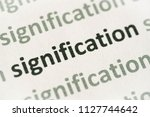 Small photo of word signification printed on white paper macro