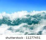 White Ocean Waves On Blue Sky...